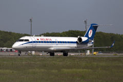 Belavia Canadair CRJ-100ER aircraft preparing for take-off from the runway Stock Image