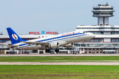 Belavia plane takes off at the Minsk airport. Belavia plane Embraer 175 takes off at the international airport Minsk Stock Images