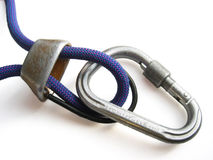Belay device. Used locking carabiner and belay device threaded with a blue climbing rope Royalty Free Stock Photography