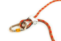 Belay device. Rock climbing belay device with red rope and locking carabiner stock photo