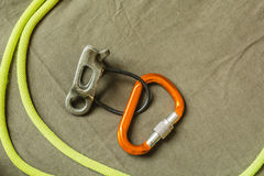 Belay device, D-shaped carabiner and rope. Stock Images