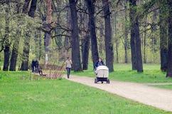 Belaya Tserkov, Ukraine - April 21, 2019: people walk in the spring park royalty free stock image