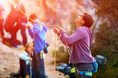 Belayer with the rope and carabines. Girl belayer with the rope and carabines Royalty Free Stock Images