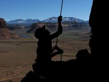 Belayer silhouette. Silhouette of a woman rock climber belayer at Indian Creek, Utah Stock Photos