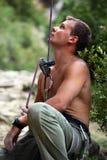 Belayer watching lead climber Stock Photo