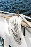 Belayingl pin on a tall ship. Coiled rope lines stored on belaying pins on a sailing vessel Royalty Free Stock Photo