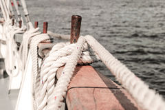Belayingl pins on a tall ship Stock Images
