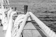 Belayingl pins on a tall ship. Coiled rope lines stored on belaying pins on a sailing vessel Stock Images