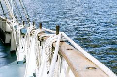 Belayingl pins on a tall ship. Coiled rope lines stored on belaying pins on a sailing vessel Stock Photos