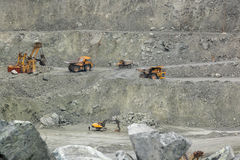BelAZ, excavators do the work Royalty Free Stock Photo