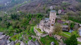 Belcastel: Castle and Village, Aveyron department, South France - 1. Aerial view in 4k from Belcastel. A small village located in Aveyron department on south of stock footage