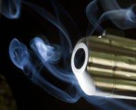 Belching smoke. Handgun barrel that is just belching out smoke Stock Photography