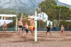 Beldibi, Turkey, October 14, 2018 a group of young people playing volleyball on the beach of the hotel complex Club royalty free stock images
