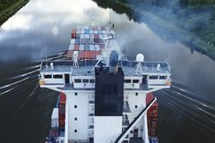 Beldorf - Exhaust fumes of container vessel at Kiel Canal Stock Photo