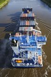 Beldorf (Germany) - Container vessel at Kiel Canal (retouched) Royalty Free Stock Photography