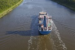 Beldorf (Germany) - Container vessel at Kiel Canal (retouched) Stock Photo