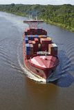 Beldorf (Germany) - Container vessel at Kiel Canal (retouched) Royalty Free Stock Photo