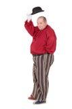 Beleibter Mann in einem roten Kostüm und in einer Melone Stockfoto