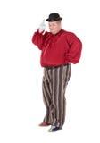 Beleibter Mann in einem roten Kostüm und in einer Melone Stockbild