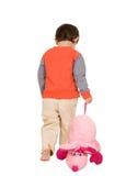 Beleidigtes Kind und Spielzeug Stockfotos