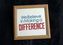 We Beleive in making a difference in wood photo frame Stock Photos