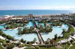 Panoramic view of the territory, beach line and pools of the lux. Belek, Turkey - June 01, 2015: Panoramic view of the territory, beach line and pools of the Royalty Free Stock Photos