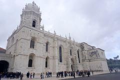 Belem Cathedral and clear blue skies. Belem Cathedral near Lisbon on a sunny day with blue skies and some clouds stock image