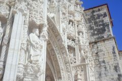 Belem Cathedral and clear blue skies. Belem Cathedral near Lisbon on a sunny day with blue skies and some clouds Royalty Free Stock Photography