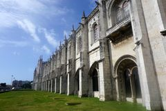 Belem Cathedral and clear blue skies. Belem Cathedral near Lisbon on a sunny day with blue skies and some clouds Royalty Free Stock Images