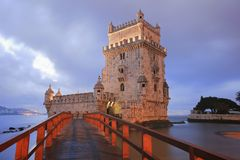 Belem Tower. Designed by architect Francisco de Arruda at twilight with River Tagus Estuary in background Stock Photo