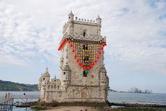 Belem tower in Lisbon. Image of the tower of Belem, a famous monument of Lisbon, with traditional red decoration. The monument is protected by the UNESCO. Photo stock photos