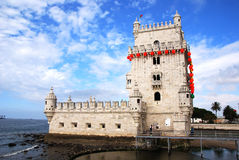 Belem tower in Lisbon. Image of the tower of Belem, a famous mounument of Lisbon, with traditional red decoration. The monument is protected by the UNESCO royalty free stock photos