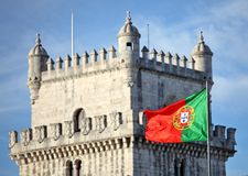Belem Tower and Portuguese flag Royalty Free Stock Photos