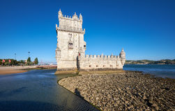 Belem Tower on river Tagus in Lisbon with reflection in water on Stock Photography