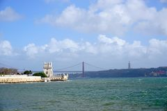 Belem Tower During Sunny Day. Near Lisbon, Portugal, with some clouds in sky Royalty Free Stock Photos