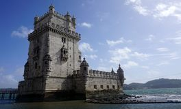 Belem Tower During Sunny Day. Near Lisbon, Portugal, with some clouds in sky Stock Photo