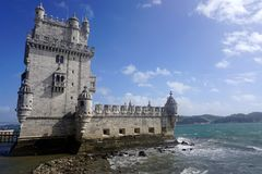 Belem Tower During Sunny Day. Near Lisbon, Portugal, with some clouds in sky Stock Image