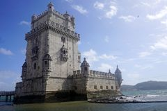 Belem Tower During Sunny Day. Near Lisbon, Portugal, with some clouds in sky Stock Photos