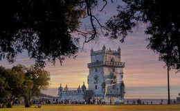 Belem tower under the pink sunset in long-rang view, Lisbon, Portugal Stock Image