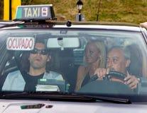 Belen Esteban. BARCELONA - JUNE 18: Belen Esteban (blond woman inside the car), a Spanish top celebrity, goes to the homosexual wedding of Luis Rollan, a famous Royalty Free Stock Photos