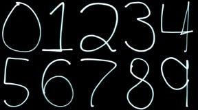 Beleuchten Sie Anstrich Zahlen Stockfotos