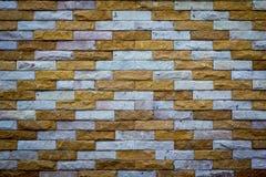 Beleuchtete alte Backsteinmauer der Backsteinmauer backgrounddimly Stockfotos