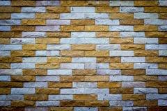 Beleuchtete alte Backsteinmauer der Backsteinmauer backgrounddimly Stockfoto