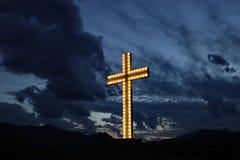 Beleuchtetes Kreuz Stockbild
