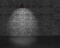 Beleuchtungsdeckenleuchten mit Backsteinmauer und konkretem Boden Stockfotografie