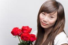 Beleza asiática com rosas Fotos de Stock