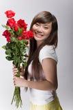 Beleza asiática feliz com rosas Fotos de Stock Royalty Free