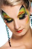 Beleza com face-arte da borboleta Fotografia de Stock