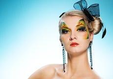 Beleza com face-arte da borboleta Fotos de Stock Royalty Free