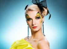 Beleza com face-arte da borboleta Imagens de Stock Royalty Free